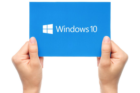 KIEV, UKRAINE - AUGUST 18, 2015:Hand holds Windows 10 logotype printed on paper. Windows 10 is an operating system developed by Microsoft.