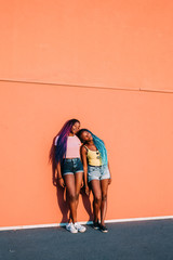 Two young beautiful black women outdoor enjoying sun