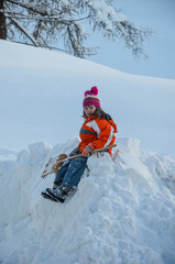 girl sitting on the snow