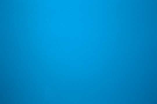 Aqua blue color on a solid stone wall as background texture. beautiful modern retro color