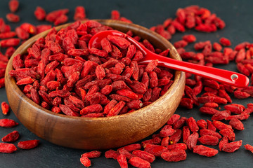 Close Up Of Dried Goji Berries In Wooden Cup. Selective Focus