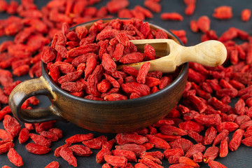 Cup with goji berries in close up. Selective focus.