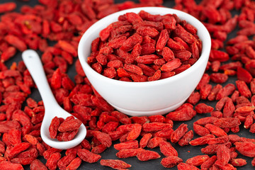 Red Organic Goji Berries In White Cup. Selective Focus