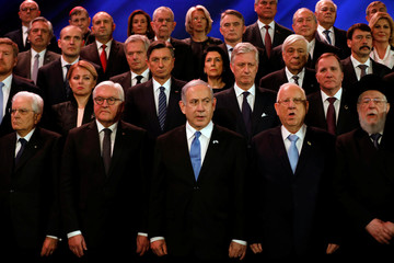 Israel's Prime Minister Benjamin Netanyahu and German President Frank-Walter Steinmeier pose for a group picture with world leaders at the World Holocaust Forum, at Yad Vashem Holocaust memorial centre in Jerusalem