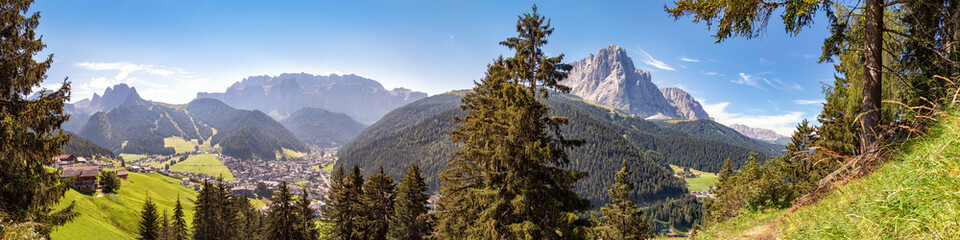 In de dag Alpen Panoramic view to Selva di Val Gardena and the mountains of the Cir Peaks, Sella, Sassolungo and Sasso Piatto, Dolomite Alps in South Tyrol, Italy