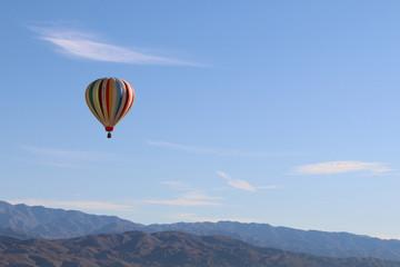 hot air balloon sky over mountains desert