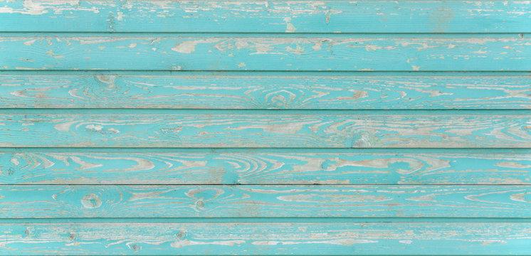 wooden texture background.boards wall horizontal peeling paint light blue sea foam color