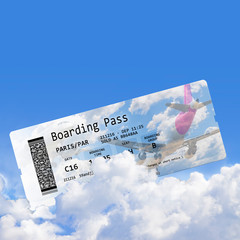 Airline boarding pass tickets isolated on cloudy sky - the contents of the image are totally invented and does not contain under copyright parts - image wiyh copy space