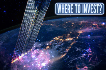 Text sign showing Where To Invest Question. Business photo showcasing asking where put money into financial schemes or shares Elements of this image furnished by NASA