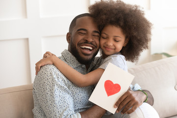 African daddy on Father Day received from caring daughter postcard