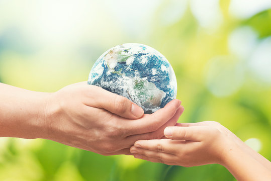 Earth globe in hands. World environment day. Elements of this image furnished by NASA.