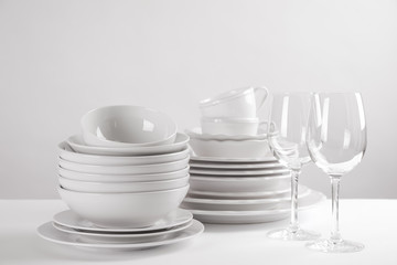 Set of clean dishes on white table
