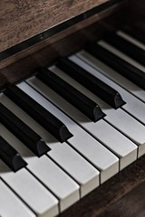 Vertical closeup of a piano under the lights - a nice picture for wallpapers and backgrounds