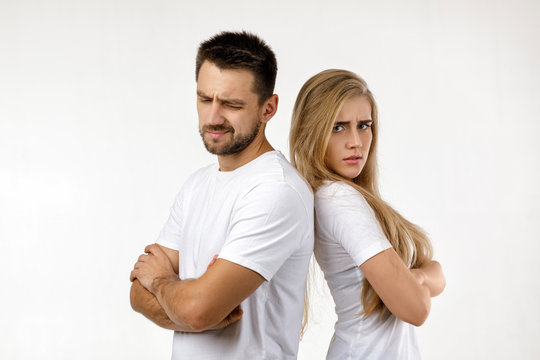 couple argued and resent each other. young woman and her boyfriend standing on white background