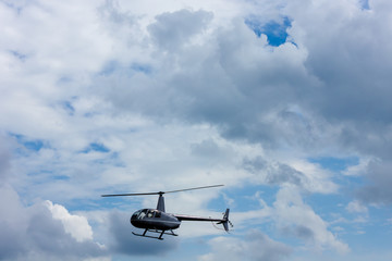 helicopter chopper with two passengers in the sky