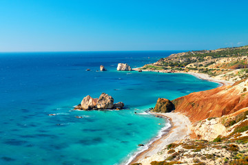 Poster de jardin Chypre Seashore and pebble beach with wild coastline in Cyprus island, Greece by Petra tou Romiou sea rocks