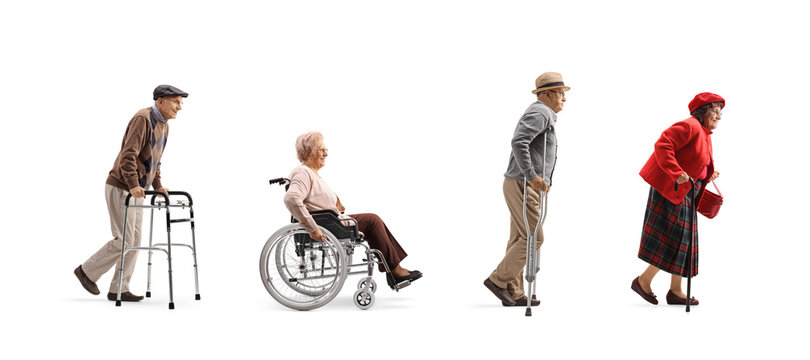 Group of senior people walking in a line with orthopedic equipment