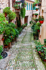 Narrow street in the smal viallge of Spello, Italy
