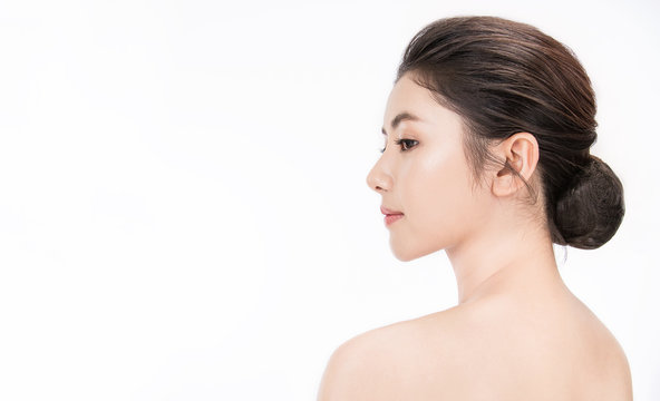 Closeup portrait of beauty asian woman with fair perfect healthy glow skin half face, young beautiful asia girl with pretty smile on her face. Beauty korean clinic skincare concept banner