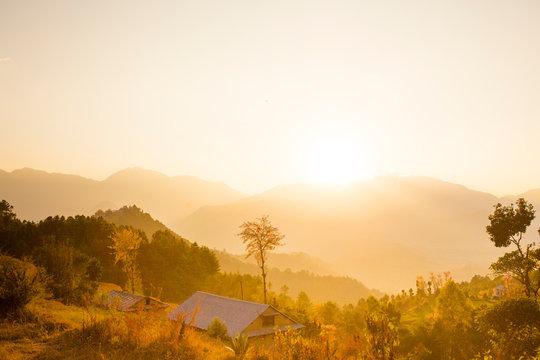 Rolling hills glowing in the sunset near Namo Buddha above Kathmandu Valley, Nepal.