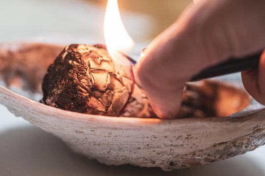 White sage burns for a spiritual cleansing practice