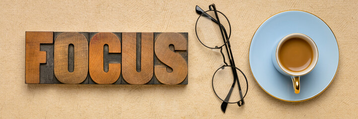 focus word abstract in wood type