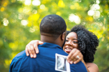 Portrait of a happy pregnant African American couple.