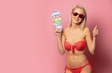 Beautiful blonde woman in red bikini and shoes
