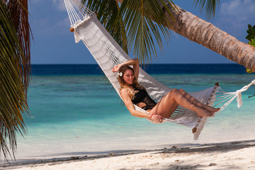 Deurstickers Ontspanning young woman relaxing on hammock
