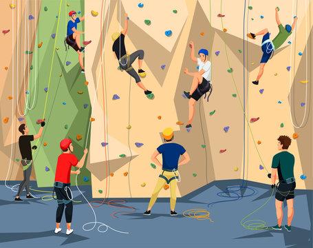 People in sportswear training on climbing wall
