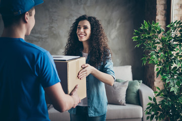 Portrait of her she nice attractive lovely cheerful cheery glad wavy-haired girl receiving taking desirable gift present surprise shop online at modern loft industrial style interior room