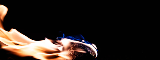 Cool picture of stone burning, isolated on black background