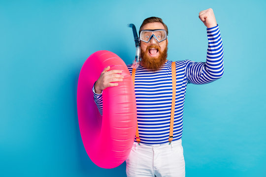Crazy man win coral reef exploration raise fists scream hold float circle wear goggles breathing tube style stylish trendy orange suspenders white shorts isolated blue color background