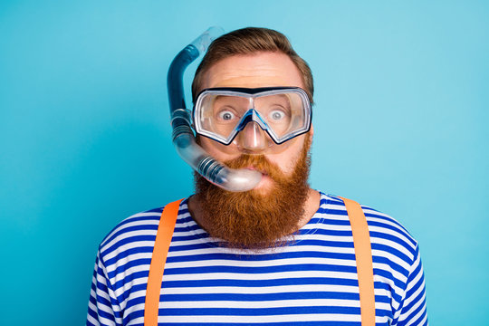 Close up photo of funky shocked red hair man watersport lover breathe diving tube have mask wear nautical vest orange suspenders isolated over blue color background