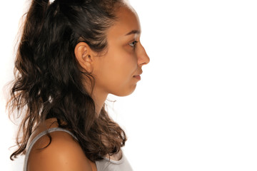 Profile of serious young indian woman on white