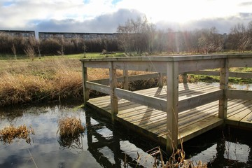 Keuken foto achterwand Ochtendgloren wooden bridge over a pond