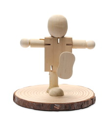 Wooden man marionette, doll standing on cross section of log isolated on white background