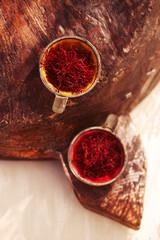Printed kitchen splashbacks Spices saffron threads in vintage dishes