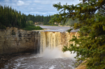 Alexandra Falls tumble 32 meters over the Hay River