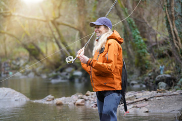 Poster Peche woman fly fishing in river