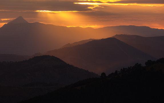 Beautiful sunrise light hits the mountains