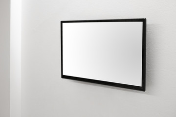LED TV blank white screen on the wall for design, advertising design concept.
