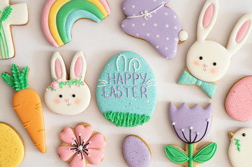 Happy Easter. Multicolored pastel easter cookies on a white background.