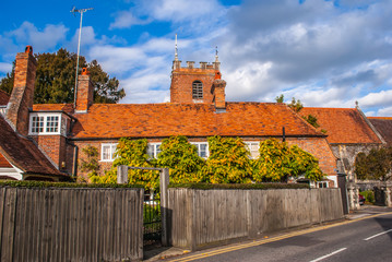 Pangbourne, Berkshire, England. October 29 2011 St. James the Less church tower showing above a row of cottages