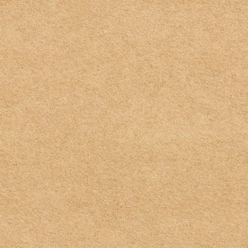 The surface of brown craft paper. Seamless texture background