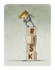 tower of cubes with the word risk in which there is a cautious man who looks down.