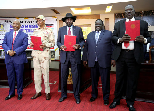 South Sudan's President Mayardit, deputy head of SPLM Arman, head of the military council Lieutenant General Dagalo, Chairman Galwak and SPLM-N chief of staff General El-Omda pose after the signing the Sudan's initial deal with rebel group in Juba