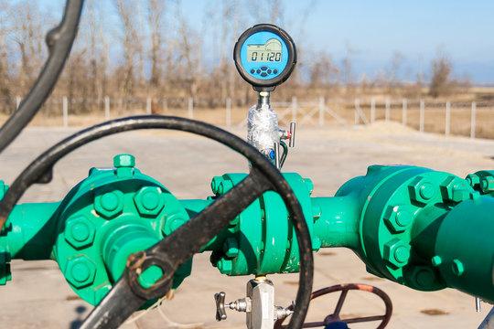 Digital pressure gauge is on the pipeline. Gas well.