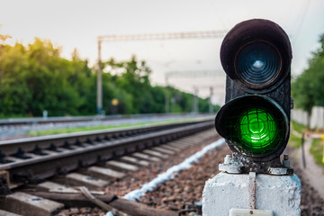 green traffic lights on the railroad Wall mural