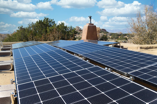 Solar panel installation on a flat New Mexico roof, in horizontal format